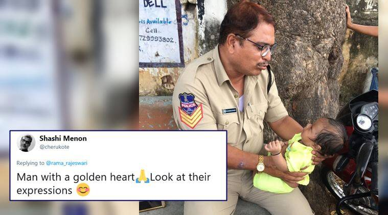 telangana, SCT PC exam, telagana police exam, police with baby photo, sctpc exam cop console crying baby, police take care baby, good news, viral news, indian express