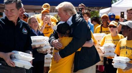 Trump comforts storm-ravaged Carolinas with hot dogs andhugs