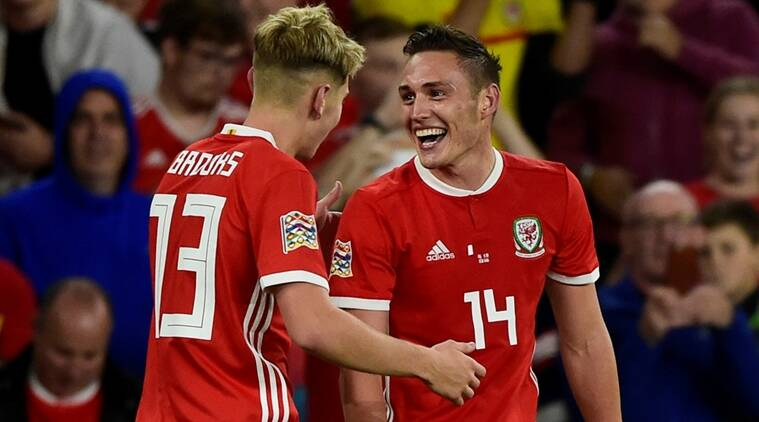 Wales' Connor Roberts celebrates with David Brooks after scoring their fourth goal against Ireland in Cardiff