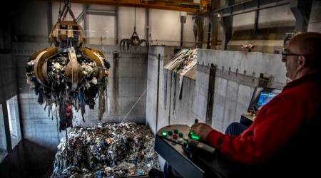 A worker in a trash to energy plant