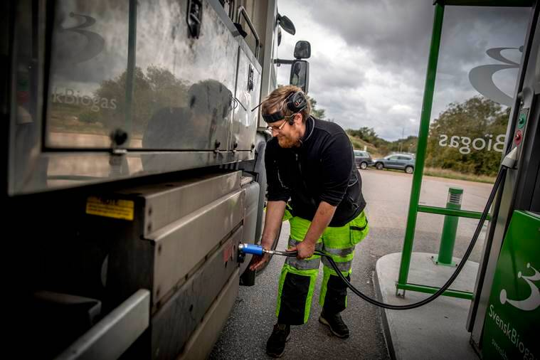 Man fills his truck with methane biogas