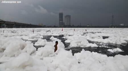 In photos: Yamuna overflows with toxic froth,filth