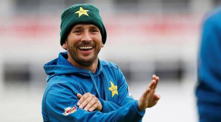 Pakistan's Yasir Shah shares a joke whilst he plays a game of football during nets