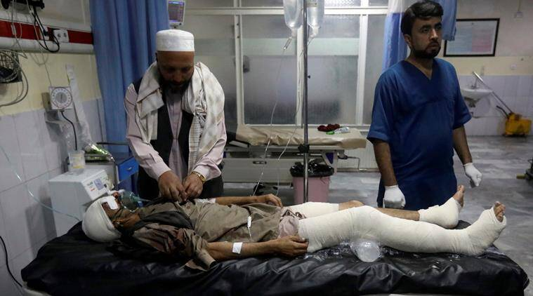 bomb blast at afghanistan election, suicide attack in Kabul, death in suicide attack, death in bomb blast, attack at afghanistan elections, afghan polls, Afghanistan election news, Indian express