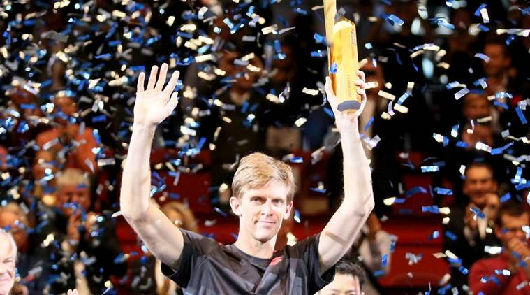 Kevin Anderson of South Africa poses with the trophy amidst a shower of confetti after winning the final match against Japan's Kei Nishikori after their final match at the Erste Bank Open tennis tournament in Vienna, Austria