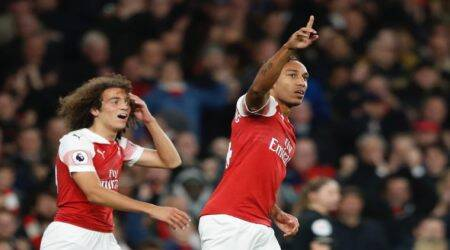 Arsenal's Pierre-Emerick Aubameyang, right, celebrates after scoring his side's third goal of the game during the English Premier League soccer match between Arsenal and Leicester City at the Emirates stadium in London