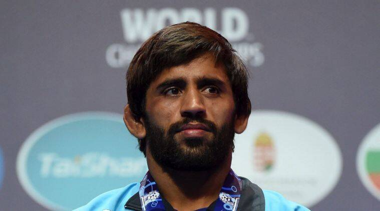 Silver medal winning Bajrang Bajrang of India stands on the podium during the medal ceremony of men's freestyle 65kg category of the Wrestling World Championships in Budapest, Hungary,