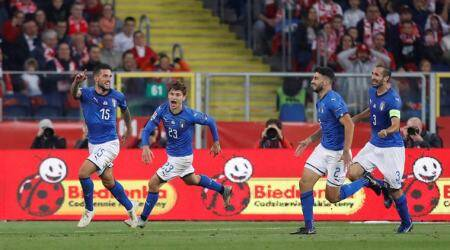 Italy's Cristiano Biraghi celebrates scoring their first goal with teammattes