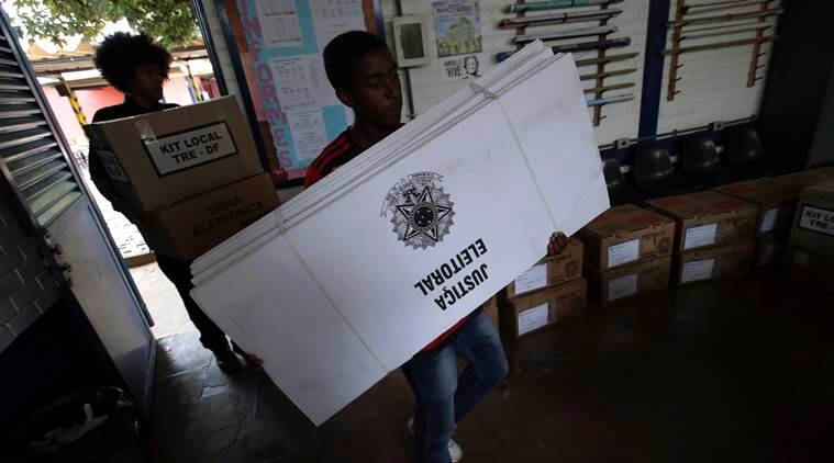 Brazil right-wing presidential candidate wins vote but runoff likely