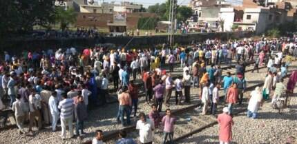 Amritsar train tragedy: Angry protesters resort to stone pelting as police tries to remove them fromtracks