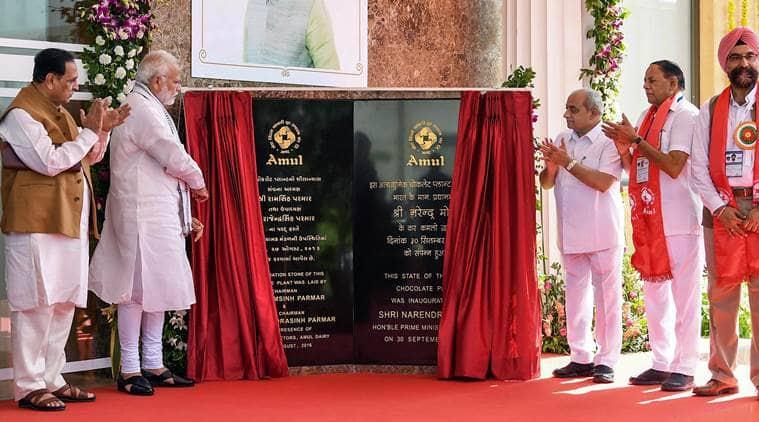 Prime Minister Narendra Modi, PM Modi, Amul event, Amul event boycott, Modi boycott, Vijay Rupani, chocolate plant, Anand news, Indian Express