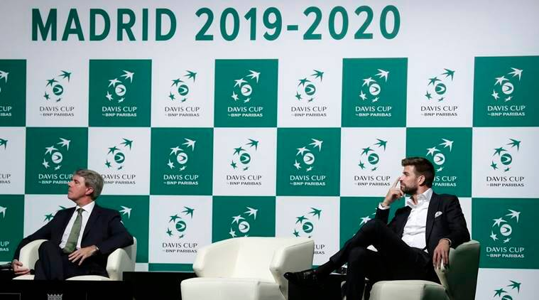 FC Barcelona football player and founder of investment group Kosmos, Gerard Pique, right, attends the presentation of Madrid as as hosts of the new Davis Cup.