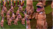 Did dancing dinosaurs just replace cheerleaders? This video will leave you ROFL-ing!