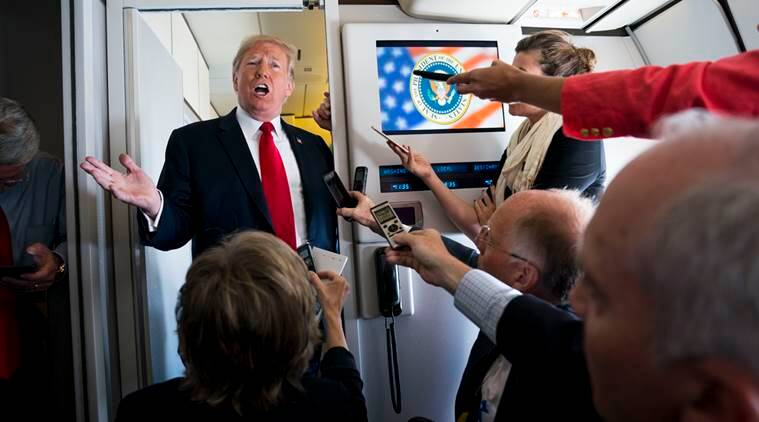 President Donald Trump speaks to reporters aboard Air Force One