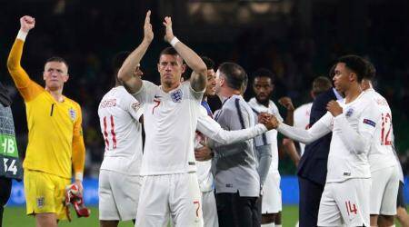 England's players wave to their fans after the UEFA Nations League soccer match between Spain and England at Benito Villamarin stadium, in Seville