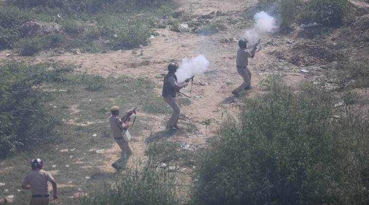 Police use teargas shells to disperse the protesters along the Delhi-Uttar Pradesh border on Tuesday. (Express photo/Gajendra Yadav)
