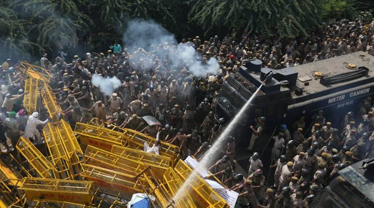 Farmers' protest in Delhi: Police use teargas shells and water cannons to disperse the protesters along the Delhi-Uttar Pradesh border on Tuesday. (Express photo/Gajendra Yadav)
