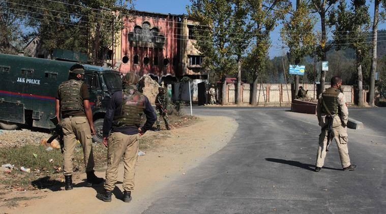 Jammu and Kashmir police men stop a media in Handwara during voting began for the first phase of the urban local bodies (ULB) elections in Jammu and Kashmir. (Express Photo by Shuaib Masoodi 08-10-2018)
