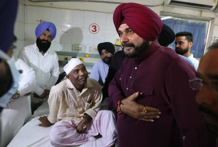 Navjot Sidhu meets the injured at Civil Hospital in Amritsar on Sunday. (Express Photo by Gurmeet Singh)