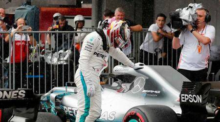 Mercedes' Lewis Hamilton celebrates pole position for the Japanese Grand Prix after qualifying