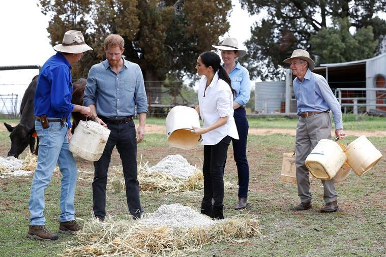 Harry and Meghan get wet in drought-stricken Outback town