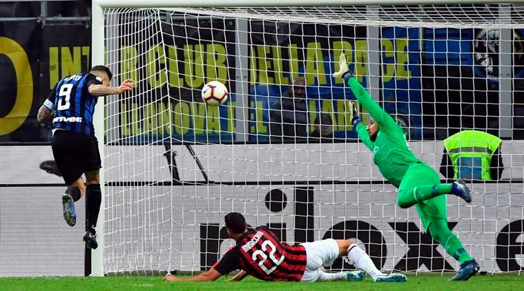 Inter Milan's Mauro Icardi, left, scores during the Serie A soccer match between Inter Milan and AC Milan at the San Siro Stadium in Milan, Italy