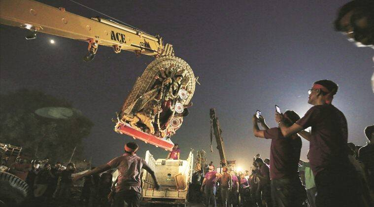 delhi dcp, yamuna ghat police attacked, dcp attacked, delhi police idol, delhi police durga idol, dcp yamuna, indian express