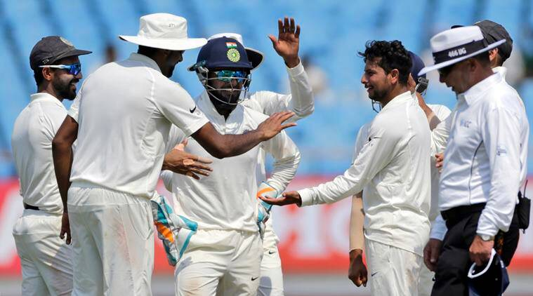 Indian cricketer Kuldeep Yadav celebrates after the dismissal of West Indies' Roston Chase during the third day of the first cricket test match between India and West Indies
