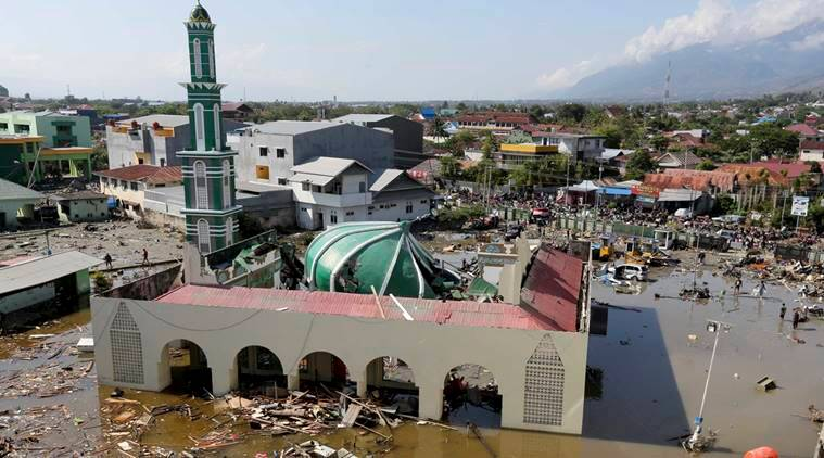 Rescuers Carry Bodies From Collapsed Roa Roa Hotel in City of Palu