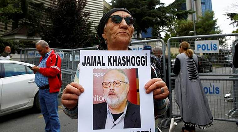 A human rights activist holds picture of Saudi journalist Jamal Khashoggi during a protest outside the Saudi Consulate in Istanbul. (Reuters)
