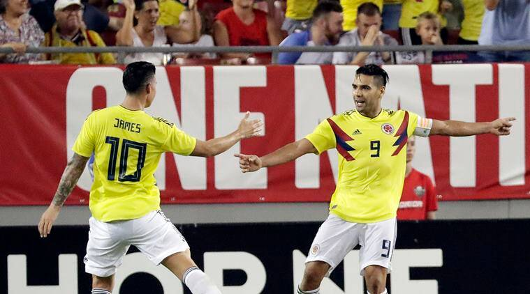 Colombia's Radamel Falcao (9) celebrates his goal against the United States with teammate James Rodriguez (10) during the second half of an international friendly soccer match