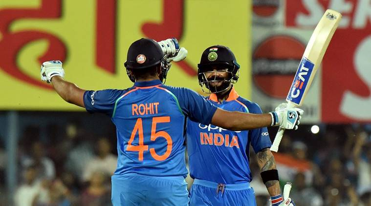 Indian cricketer Rohit Sharma celebrates his century with captain Virat kohli during the first One Day International cricket match against West Indies, at ACA Cricket Stadium, Barsapara in Guwahati