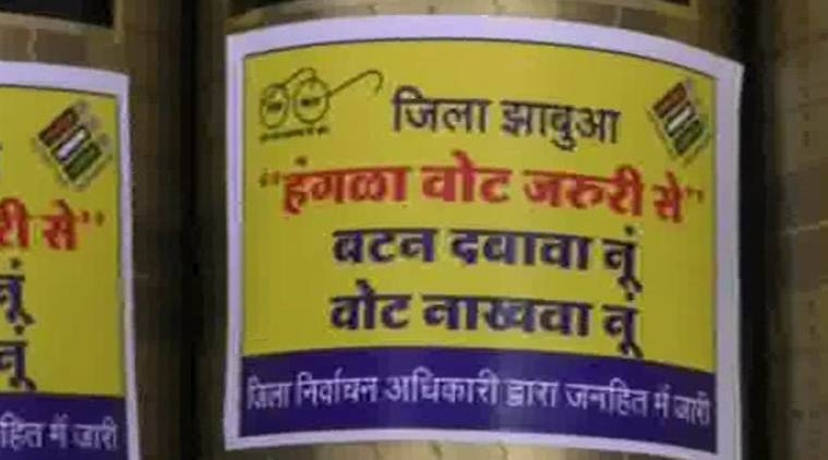 Shopkeepers said the stickers which were provided by the excise department carried messages urging people to 'hit the (voting) button' without fail. (ANI)