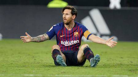 Barcelona forward Lionel Messi reacts after failing to score against Valencia during the Spanish La Liga soccer match between Valencia and Barcelona, at the Mestalla stadium