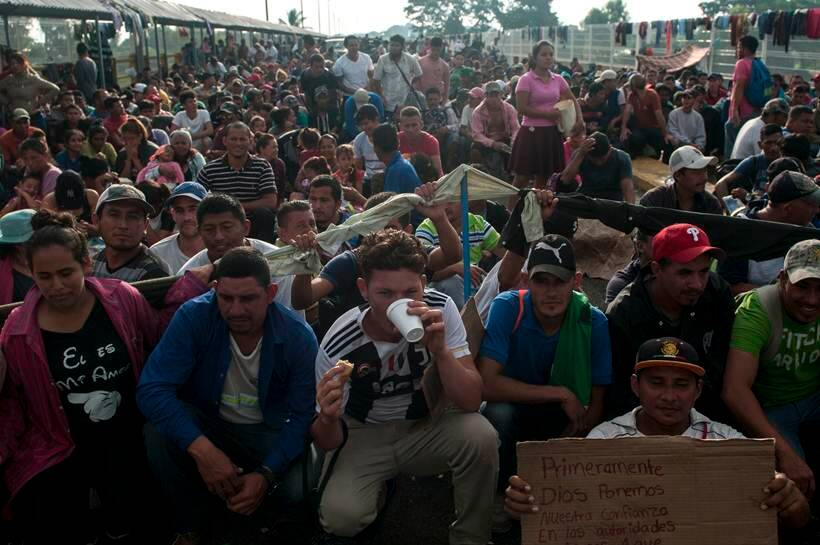 Thousands of Honduran migrants in US-bound caravan head into Mexico