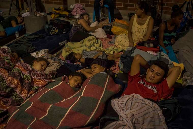 Honduran migrants rest at a church-run shelter in Guatemala City.