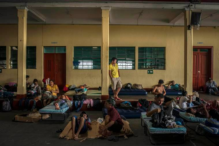 Migrants, nearly all Hondurans, rest at a school  in Guatemala City.