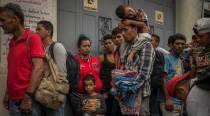 What is the 'Migrant Caravan' headed towards the US border and why does Trumpcare?