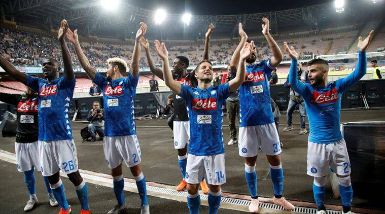 Napoli players celebrate in front of fans after the match