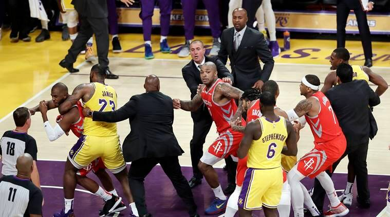Houston Rockets' Chris Paul, far left, is held back by Los Angeles Lakers' LeBron James, second from left, after Paul fought with Lakers' Rajon Rondo, far right, during the second half of an NBA basketball game Saturday, Oct. 20, 2018, in Los Angeles.