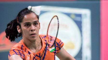 Saina Nehwal of India in action against Tai Tzu Ying of Chinese Taipei, during the Women's Singles Final match aof the Denmark Open badminton championship, in Odense, Denmark