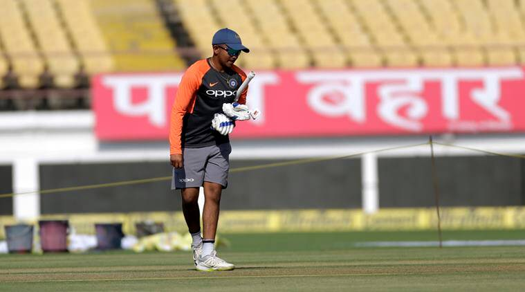 Indian cricketer Prithvi Shaw inspects the wicket during a practice session before the first test match against West Indies in Rajkot