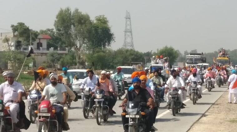 Party supporters throng the streets of Punjab on Sunday. (Express photo)