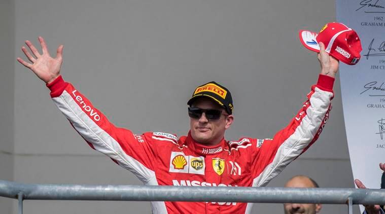 Ferrari driver Kimi Raikkonen (7) of Finland celebrates winning the United States Grand Prix at Circuit of the Americas.
