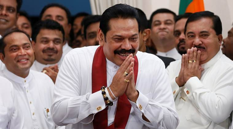 Sri Lanka's newly appointed Prime Minister Mahinda Rajapaksa gestures during a ceremony to assume charge as PM