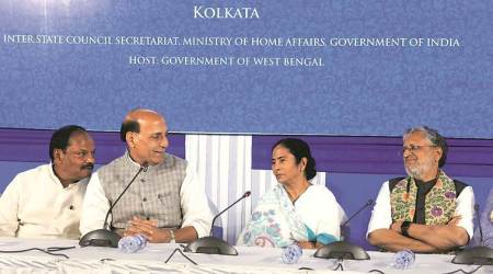 Home Minister Rajnath Singh, CM Mamata Banerjee and her Jharkhand counterpart Raghubar Das at Nabanna. (Express photo)