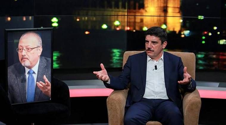 Yasin Aktay, an advisor to Turkey's President Recep Tayyip Erdogan and a good friend sits next to an empty chair with a picture of Saudi writer Jamal Khashoggi placed on it, speaks during a live television program for London-based TV station al-Hewar, in Istanbul, late Thursday. (AP)