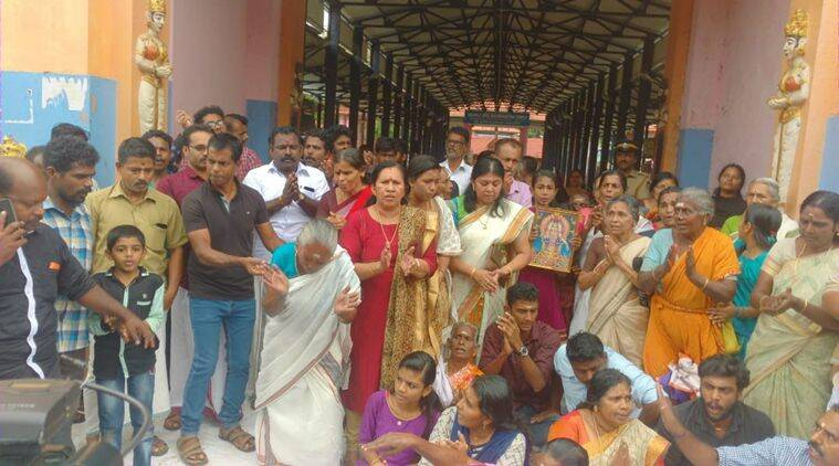 Women devotees protest against the SC verdict outside Erumeli Dharma Shastha Temple in Kerala on Friday. (Express photo)