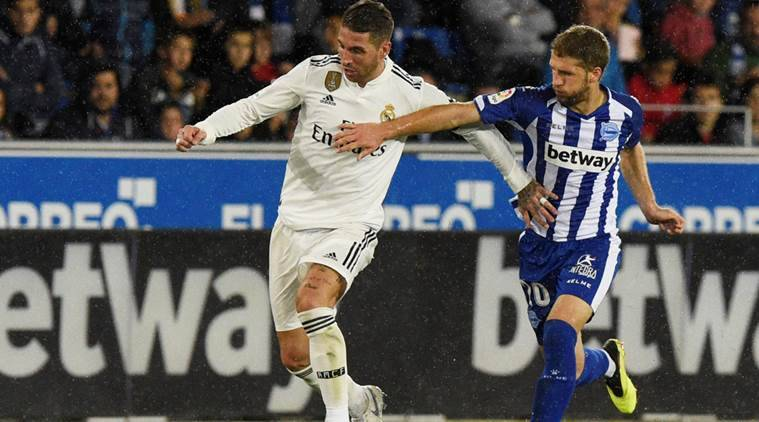 Real Madrid's Sergio Ramos in action with Alaves' Darko Brasanac REUTERS