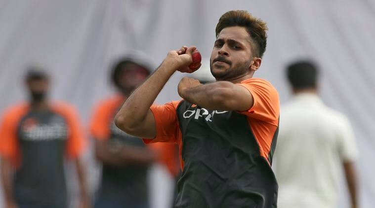 Indian cricketer Shardul Thakur bowls during a practice session ahead of their second test match against West Indies in Hyderabad